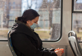 tired woman in medicine face mask in city transport - PhotoDune Item for Sale