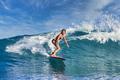 Female surfer on a blue wave - PhotoDune Item for Sale