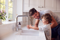 Father Helping Son To Wash Hands With Soap At Home To Stop Spread Of Infection In Health Pandemic - PhotoDune Item for Sale