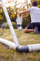 Father With Son Having Fun In Park Or Garden Playing Soccer Together - PhotoDune Item for Sale