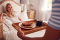 Husband Surprising Wife With Breakfast In Bed At Home - PhotoDune Item for Sale