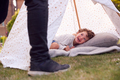 Close Up Of Father And Son Having Fun With Tent Or Tepee Pitched In Garden - PhotoDune Item for Sale