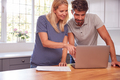 Couple With Pregnant Wife At Home Buying Products Or Services Online Using Laptop - PhotoDune Item for Sale