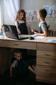 Distance learning, home education, remote lessons concept. Two schoolchildren near open laptop and - PhotoDune Item for Sale