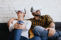 Young Couple Playing With Virtual Reality - PhotoDune Item for Sale