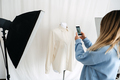 AR VR Technology in Fashion Industry. Female designer shotting clothes on mannequin by cell phone - PhotoDune Item for Sale