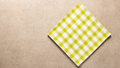 Checked tablecloth at stone surface of table. Top view of cloth napkin texture background - PhotoDune Item for Sale