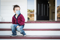 Melancholy Mixed Race Boy On Front Porch Wearing Medical Face Mask - PhotoDune Item for Sale