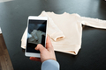 Sell Online on the Internet. Ecommerce store. Woman taking photo of clothes on smartphone. Selling - PhotoDune Item for Sale