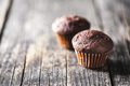 Chocolate muffins. Sweet dark cupcakes. - PhotoDune Item for Sale