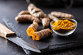 Indian turmeric powder and root. Turmeric spice. Ground turmeric. - PhotoDune Item for Sale