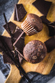 Chocolate muffins. Sweet dark cupcakes with chocolate and vanilla pods. - PhotoDune Item for Sale