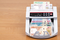 New money from Qatar in the counting machine - PhotoDune Item for Sale