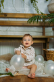 Cute little baby toddler princess at first birthday party at home. 1st Birthday home party ideas - PhotoDune Item for Sale