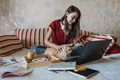 Freelance young woman working in home office with laptop computer and cat. Remote online working - PhotoDune Item for Sale