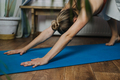 Home Fitness, workout in new normal, pandemic lockdown time, Yoga at home. Young woman working out - PhotoDune Item for Sale