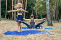 Safe gym or exercise class outdoor. Family staying fit by exercising together in parks. Mother - PhotoDune Item for Sale
