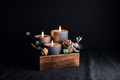 Decorations with wooden box and black burning candles in a dark interior. - PhotoDune Item for Sale