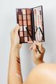 woman choosing eyeshadow palette for make up - PhotoDune Item for Sale