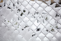 Wire mesh fence covered with snow, winter background - PhotoDune Item for Sale
