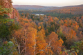 Hills trees and a small lake surrounded by trees in autumn color at sunrise in northern Minnesota - PhotoDune Item for Sale