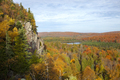 Cliff and small lake surrounded by trees in autumn color in northern Minnesota - PhotoDune Item for Sale