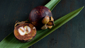 Mangosteen fruits on wooden table - PhotoDune Item for Sale