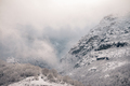 Fog and snow between cliffs and forests - PhotoDune Item for Sale