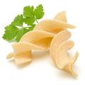 Italian  twisted pasta fusilli isolated on white background. Fusilloni, rotini. - PhotoDune Item for Sale