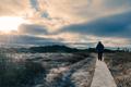 Hiker on wooden boardwalk frozen winter landscape - PhotoDune Item for Sale