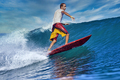 Male surfer on a blue wave at sunny day - PhotoDune Item for Sale