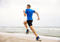 male runner running edge of sea - PhotoDune Item for Sale