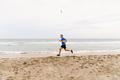 male jogger run edge of sea - PhotoDune Item for Sale