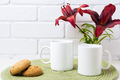 Two coffee mug mockup with red lily and cookie - PhotoDune Item for Sale