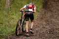 rider cyclist with mountain bike uphill - PhotoDune Item for Sale