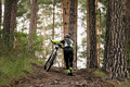 man cyclist with mountain bike goes uphill - PhotoDune Item for Sale