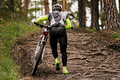 back rider with mountain bike goes uphill - PhotoDune Item for Sale