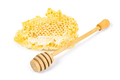 Piece of honeycomb with honey dipper on white background - PhotoDune Item for Sale