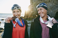 Two sisters, triathletes with medals - PhotoDune Item for Sale