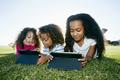 Three children sharing digital tablets - PhotoDune Item for Sale