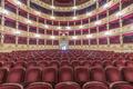 Interior of the Teatro Verdi, red velvet seats in the auditorium, Trieste, Italy. - PhotoDune Item for Sale