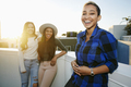 Three young women on a rooftop at dusk - PhotoDune Item for Sale