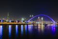 Night, cityscape of Dubai, tall buildings and waterfront, and arch over the creek. - PhotoDune Item for Sale