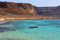 Sea view with clear turquoise water and empty boat, Crete island, Greece - PhotoDune Item for Sale