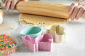 Female model rolls dough with rolling pin on kitchen table - PhotoDune Item for Sale