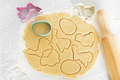 Dough with cookie cutters and rolling pin on kitchen table - PhotoDune Item for Sale