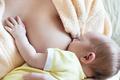 Baby eating breast milk. - PhotoDune Item for Sale
