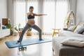 Pregnant woman doing exercises - PhotoDune Item for Sale