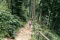 Rear view of a woman with a backpack in the mountains in a nature reserve. - PhotoDune Item for Sale