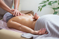 Caucasian woman getting a spine massage in the spa salon - PhotoDune Item for Sale